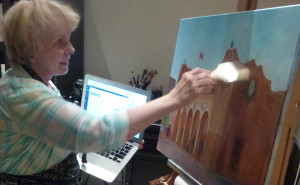 Gail painting and writing