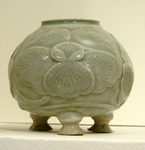 A 10th-century celadon pot from China (Musee Guimet, Paris). Celadon is a pale greyish green which takes its name from a character in the French romance Astrée by d'Urfe (1610).
